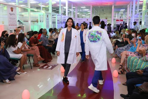 Gulf Medical University Hosts first-ever 'White Coat Fashion Show' by Healthcare Heroes